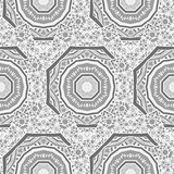 Seamless  pattern of round ornaments and other abstract elements. Stock Photos