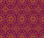 Seamless pattern with round vintage ornaments in purple and gold colors. Outline mandala symbol. Royalty Free Stock Image