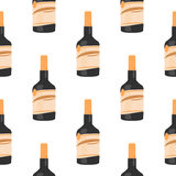 Seamless pattern of rum bottle on white background isolation Stock Images