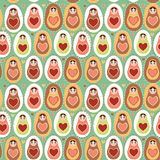 Seamless pattern Russian dolls matryoshka mint pink brown.  Stock Photography