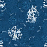 Seamless pattern with sailboats and wind compass on blue. Seamless nautical background with sailboats, wind compass and mystic symbols on blue.  Endless Royalty Free Stock Photo