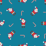 Seamless pattern with Santa Claus and candy cane Stock Photo