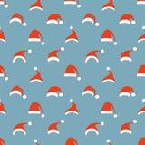 Seamless pattern of Santa hats. Stock Photo