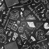 Seamless pattern school supplies on a blackboard Stock Image
