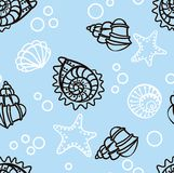 Seamless pattern with seashells on blue background Royalty Free Stock Photo