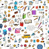 Seamless pattern with set of different school things.Doodle seamless background with school icons. Stock Images