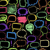 Seamless pattern with set of doodle sketch speech bubbles on blackboard hand-drawn with color chalks. Stock Photos