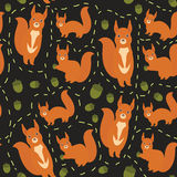 Seamless pattern Set of funny red squirrels with fluffy tail with acorn on black background. Vector Stock Photo