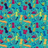 Seamless pattern with sewing accessories. On a turquoise background Stock Photography