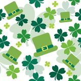 Seamless pattern with shamrocks and irish hats Stock Images