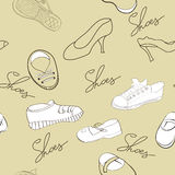 Seamless pattern with shoes. Universal template for greeting card, web page, background Royalty Free Stock Photos