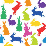 Seamless pattern with silhouettes of bunnies. In rainbow colors made in vector Royalty Free Stock Photography