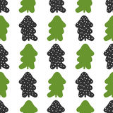 Seamless pattern with silhouettes of Christmas trees and round snowflakes. Stock Photos