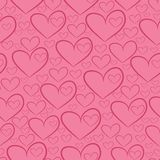 Seamless pattern with silhouettes of hearts Stock Photos