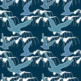 Seamless pattern with silhouettes of sea gull flying against a background of a night storm. Stock Photography