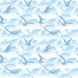 Seamless pattern with silhouettes of sea gull flying against a background of waves. Royalty Free Stock Images
