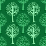 Seamless pattern with silhouettes of trees, vector hand drawn Stock Photo
