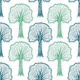 Seamless pattern with silhouettes of trees, vector hand drawn Stock Image