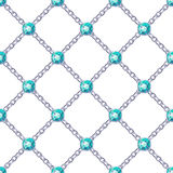 Seamless pattern with silver chains and emeralds. Stock Photo