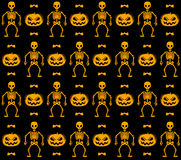 Seamless pattern with skeletons, pumpkins and bats Royalty Free Stock Photography