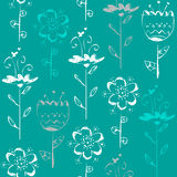 Seamless pattern with sketch flowers on blue background Stock Photos