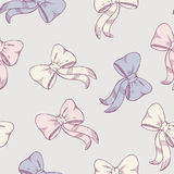 Seamless pattern with sketched bows in pastel colors Royalty Free Stock Images