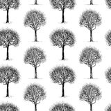 Seamless pattern of sketches of deciduous trees in winter. Vector background of sketches of deciduous trees the cold seasons royalty free illustration