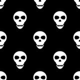 Seamless pattern with skulls on a black background Royalty Free Stock Photo