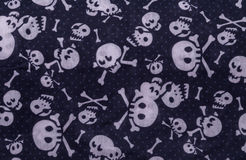 Seamless pattern with skulls on blue Royalty Free Stock Photos