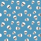 Seamless pattern with skulls on blue. Background vector illustration