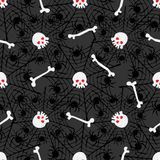 Seamless pattern with skulls, bones, spiderwebs Stock Images