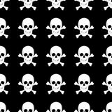 Seamless pattern with skulls and bones. Royalty Free Stock Image