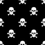 Seamless pattern with skulls and bones. Stock Photos