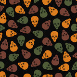Seamless pattern of skulls on a dark background Royalty Free Stock Images