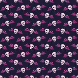 Seamless pattern with skulls and glittering wings. Background in dark blue and pink colors. Vector illustration Stock Photos