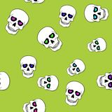 Seamless pattern with skulls and hearts on green Royalty Free Stock Images