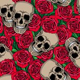 Seamless pattern with skulls and red roses Stock Image