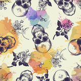 Seamless pattern with skulls and rose flowers drawn in engraving style and translucent colorful blots. Modern and trendy Stock Photos