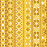 Seamless pattern with Slavic style elements. In yellow, brown, white colors. Vertical chains of various geometric shapes forming beautiful ethnic ornament Royalty Free Stock Images