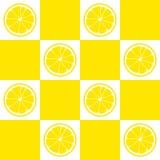 Seamless pattern. Slices of lemon on background of yellow and white squares. Seamless pattern. Slices of lemon on background of yellow and white squares Stock Photo
