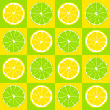 Seamless pattern. Slices of lemon and lime on background of yellow and green squares. Royalty Free Stock Image