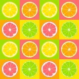 Seamless pattern. Slices of lime, lemon, grapefruit, orange on background of yellow, pink, green and orange squares. Stock Image