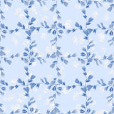 Seamless pattern small blue branches and light leaves on a light blue background. Floral background. Watercolor Royalty Free Stock Photo