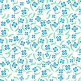 Seamless pattern of a small blue flowers. Stock Image