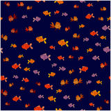 Seamless pattern of small fish on a blue background Stock Photography