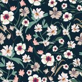 Seamless pattern with small flowers on a dark background. Modern fashionable floral texture for fabric, wallpaper, interior, tiles, print, textiles, packaging Royalty Free Stock Image