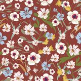 Seamless pattern with small flowers on a dark background. Seamless pattern with small flowers on a bordo red background. Modern fashionable floral texture for Stock Photography