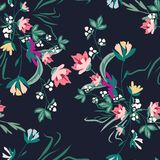 Seamless pattern with small flowers on a dark background. Modern fashionable floral texture for fabric, wallpaper, interior, tiles, print, textiles, packaging Royalty Free Stock Images