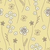 Seamless pattern with small flowers on a yellow background Stock Image
