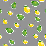 Seamless pattern with small lemons and limes with green leaves. Gray background. Stock Photo
